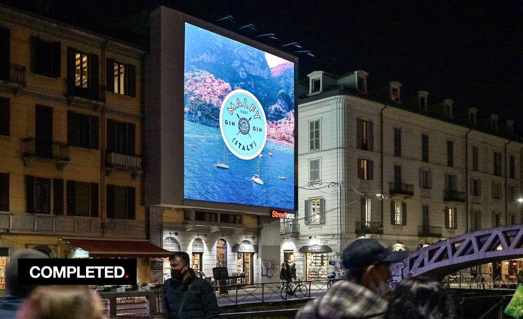 Maxi Affissione Streetvox in Via Corsico 12 sui Navigli a Milano con MALFY (beverage)