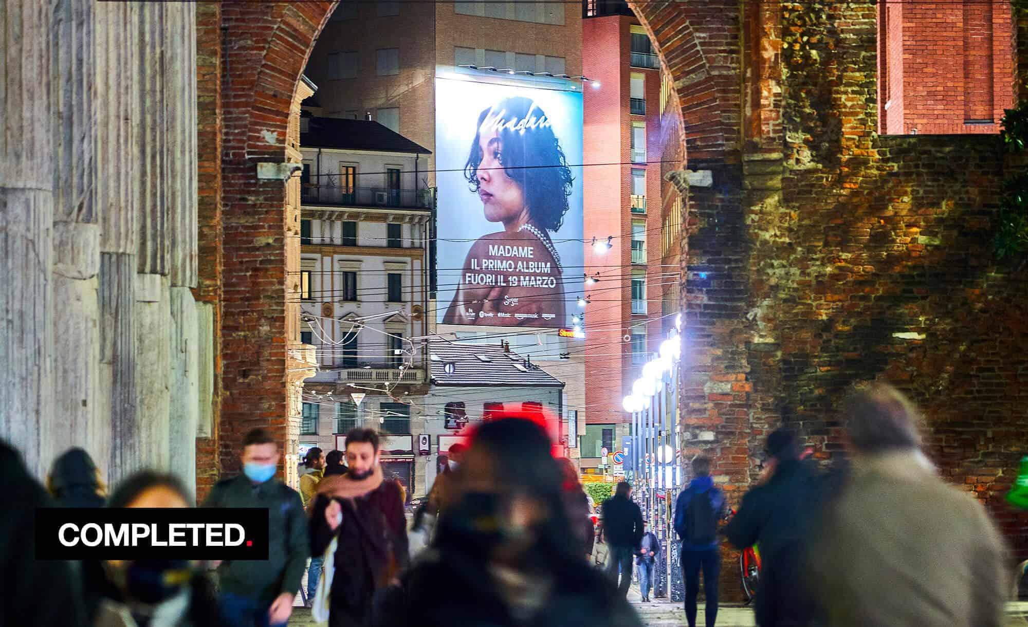 Maxi Affissione a Milano in Largo Carrobbio con Sugar Music e Madame (Entertainment)